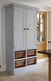 Free Standing Kitchen Cabinets In White With Wicker Storage Also Dark  Granite Countertop