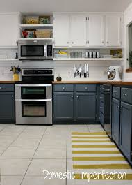 budget kitchen remodel painted tow tone cabinets raised cabinets floating shelf butcher