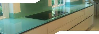 blue green looking glass worktop with a hob cooker installed