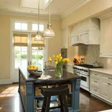 rustic french country kitchens. Modren Kitchens French Country Kitchen With Blue Island And Rustic Range Hood To Kitchens