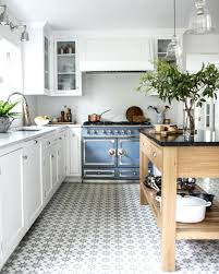 patterned tile floors patterned kitchen tiles small wooden island and white cabinets also patterned tiles floor