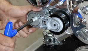 serpentine belt tensioner. spring loaded serpentine belt tensioner