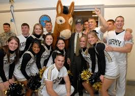 u s department of defense photo essay deputy defense secretary gordon england poses army black knight cheerleaders during a nov 30