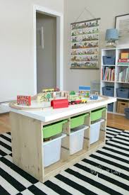 This train table using the IKEA TROFAST is a great IKEA toy storage hack.  Via