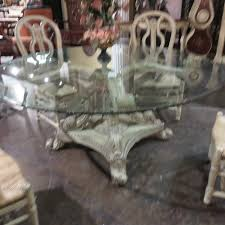 angelia hand carved parchment glass top pedestal 72 dining table