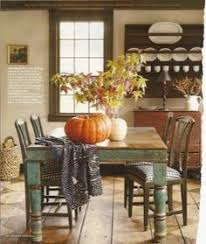 i love this table and chairs a distressed wood table feels at home in a farmhouse dining room blue and white checd seat cushions plement the faded