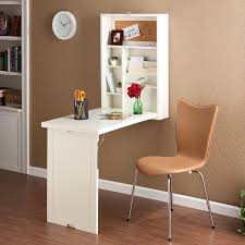 this winter white writing desk folds up onto the wall neat and compact fold the desk down for a convenient storage area