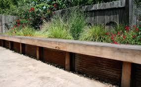 corrugated metal retaining wall seat was added to provide additional seating multi savage landscape architecture diy