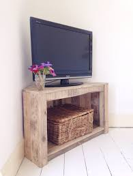 compact small rustic wooden corner tv stands with single open compartment fitted with woven box