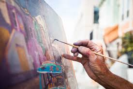 local artist works on an oil painting of a lowrider with florida street scene on florida street near 26th street in the mission district san francisco