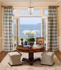 french doors covering with blue bufallo check ds and hung high above door also surrounding glass window and liner curtain rod also fl pattern