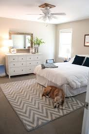 rectangle white grey rugs with zig zag pattern decorated by and wooden vanity table in bedroom