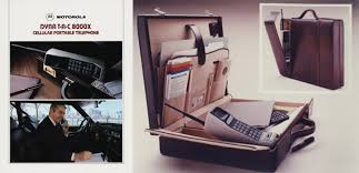 motorola 8000x. motorola dynatac 8000x portable cellular phone brochure cover (left) and briefcase compartment product photo (right), circa 1984. 8000x