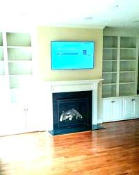 hanging tv over fireplace mounting a above mounted mounts on brick hanging tv over fireplace