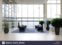 office reception interior. The Interior Of A Large Office Reception With Seating Plants And Smoked Glass Windows F