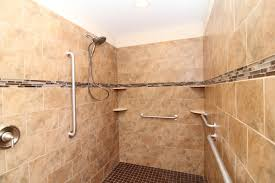 handicap bathrooms for home. roll in wheelchair accessible shower. grab bars. tile soap trays. handicap bathrooms for home