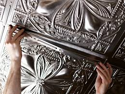sagging tin ceiling tiles bathroom: faux tin ceiling roll on the cement and install