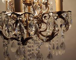 7 of 12 antique 6 arms brass crystals chandelier from 1950 s