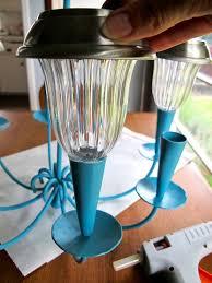 hot glue solar lights onto candle holders
