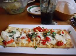 one ordered this delicious looking appetizer dish the grilled en flatbread consisting of grilled en mozzarella cheese roasted red peppers