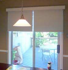 pendant lighting and sliding glass door coverings with wood decks