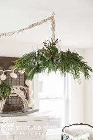 i ve been dressing my chandeliers for like this for a few years now and it s always the no brainer in my holiday decor