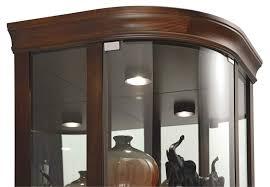 680529 howardmiller curio cabinet has halogen lighting with curved flat top 680529 howardmiller corner cabinet with four adjule glass