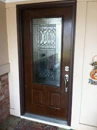 exterior door fiberglass or steel. the wood-grain steel entry door system with 3/4 lite glass using our exterior fiberglass or