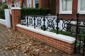 Small Picture Stylish red brick wall and black railings in London front garden