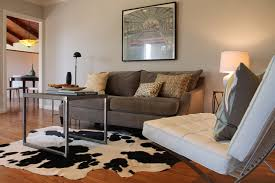 Cowhide Rug, Barcelona Chair and Vintage Print eclectic-living-room