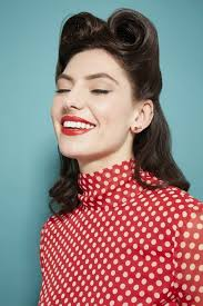 1940s hairstyles brute model with um length hair styled in victory rolls for retro photoshoot