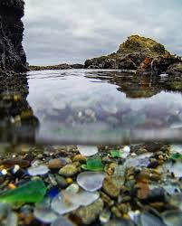 glass beach from above and below photo by travis burke