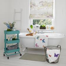R Vintage White Bathroom With Rolltop Bath And Blue Storage Unit