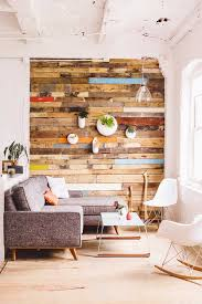 wooden pallet planks doubling as background for vertical greenery in airy decor