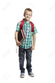 8 year old boy with backpack holding books on white background stock photo 14795412