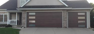 what an amazing difference a new garage door can make on the appearance of your home