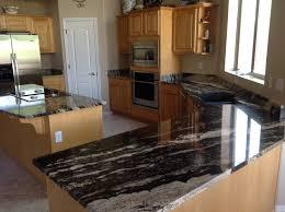 unique dark granite countertops and cabinets