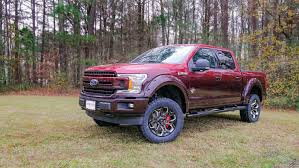 ford f150 trucks lifted.  Lifted Ford F150 Red Fade With 4 Inch Liftjpg Inside Trucks Lifted L