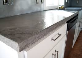 wet look sealer applied to concrete counters for a shiny finish