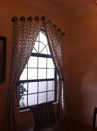 Arched Window Treatment With Geometric Curtain And Rounded Accessories Atop  For Decoration