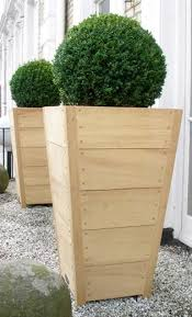 Build this simple but elegant tall wooden planter for $50 or less following  this detailed building plan and tutorial. The planter is 3 feet tall an