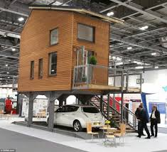 architect bill dunster has designed a range of tiny flats that stand on stilts above car