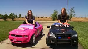 power wheels race disney princess vs police charger