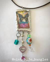 erfly and bluebird beauty double sided glass and solder pendant