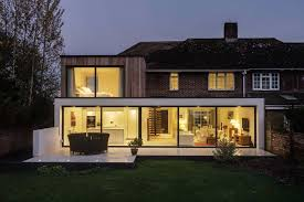 View in gallery The Beckett House modern extension, night