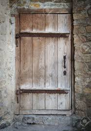 old wooden door in a stone wall stock photo 45734194