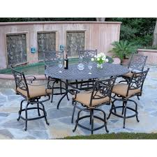 bar height patio chair: elegant brown fabric cushioned seat porch dining chairs combined oval black polished cast iron table with