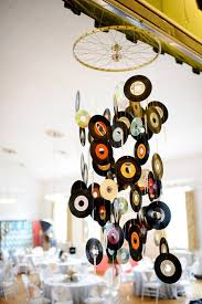 do you have old records that you can t do anything with don t throw those out either instead string them up into a decorative chandelier