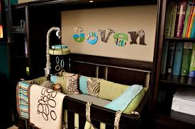 contemporary nursery furniture decors with espresso wooden convertible toddler crib and decals in dark baby boy rooms ideas