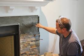 building our fireplace installing the slate split face tile